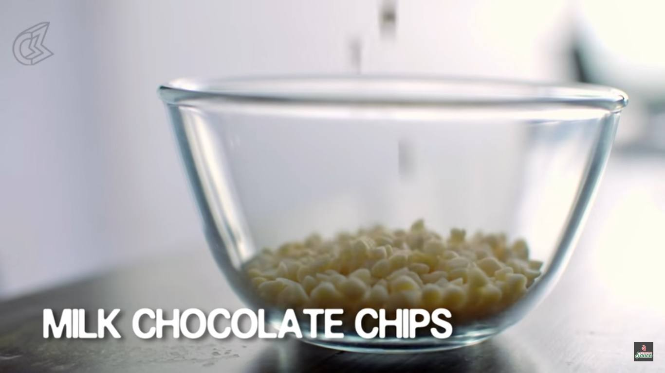 Take some white chocolate chips in a bowl.